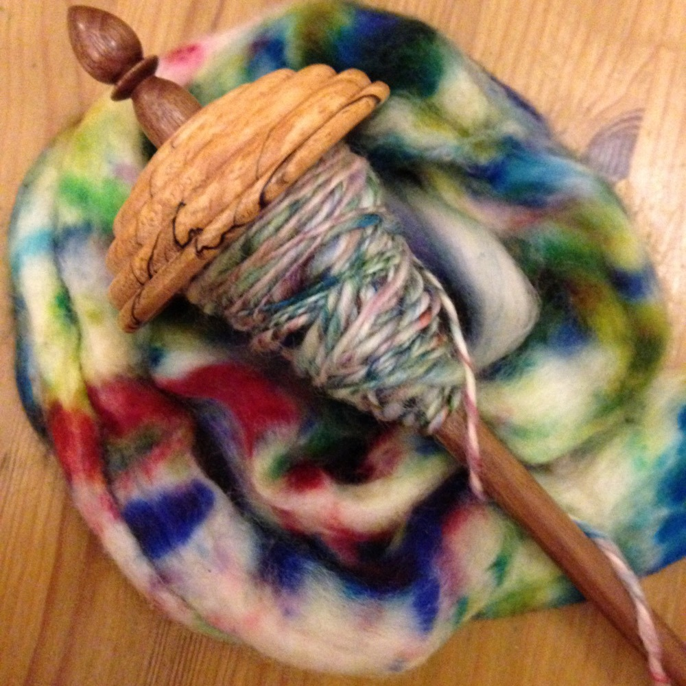 hand spun mottled yarn on drop spindle